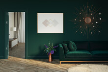 Interior Of A Green Room With An Open Door To A Beige Room. The Bouquet In A Jug Is On The Parquet Floor Next To The Green Sofa. There Is A Horizontal Poster On The Wall Next To The Mirror. 3d Render