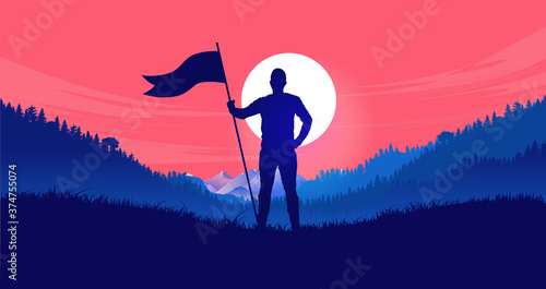 Photo Holding flag in front of red sky - Man standing in landscape with raised flag ready to take on any challenge