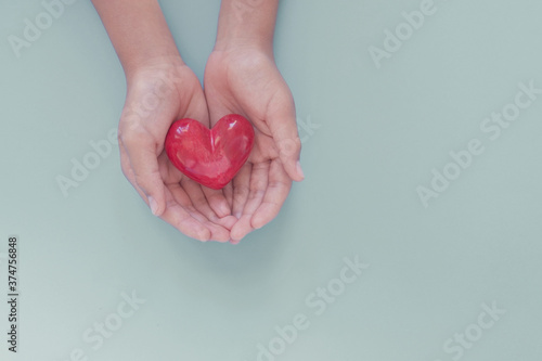 Obraz hands holding red heart, organ donation, wellbeing, health insurance and CSR concept, world heart day, world health day - fototapety do salonu