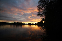 Sunset On A Forest Lake With A...