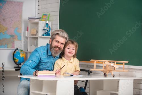 Father teaching son Canvas Print