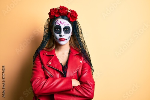 Woman wearing day of the dead costume over yellow skeptic and nervous, disapproving expression on face with crossed arms Fototapet