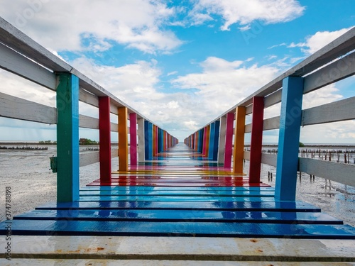 Fotografie, Obraz Rainbow Bridge and seaside bridge, bright colors, eye-catching contrast with the clear blue sky