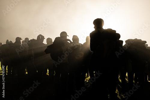 Fotografie, Obraz Group of men silhouette with foggy backlight