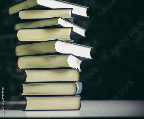 Tela The books are placed in a stack of books on the table