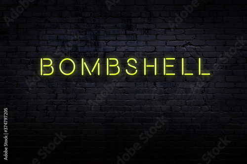 Neon sign. Word bombshell against brick wall. Night view Canvas Print