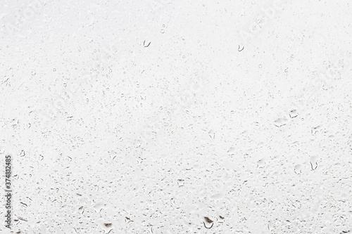 Canvastavla Rain drops on window glasses surface with gray sky background