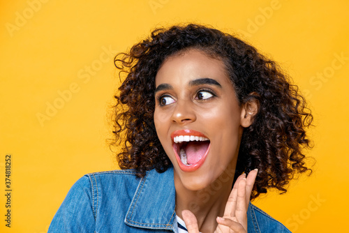 Photo Fun close up portrait of young surprised African American woman with mouth open