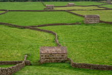 Swaledale Barns Near Gunnerside From Above In The Yorkshire Dales England. North Yorkshire Stone Barns And Dry Stone Walls.
