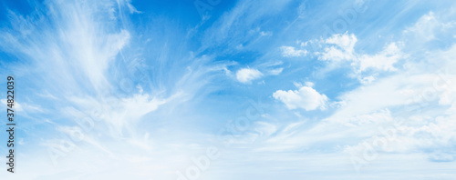 Obraz International day of clean air for blue skies concept: Abstract white puffy clouds and blue sky in sunny day texture background - fototapety do salonu
