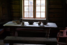 Medieval Simple Farmers Dining Table By The Window With Natural Sunlight Steaming In.