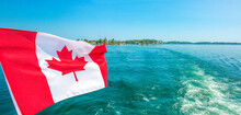 Canadian Flag Blowing In The Wind Thousand Islands Canada Ontario