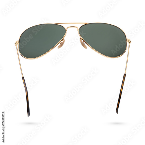 Photo Classic aviator sunglasses with golden frame isolated on white.