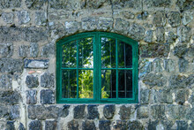 Green Vaulted Window On A Cind...