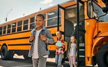 Children Near School Bus