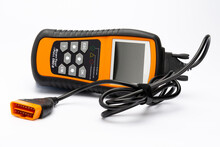 Car Fault Code Reader With OBD2 Plug On White Background