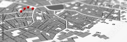 Fototapeta Rote Stecknadeln als Position Markierung in Stadtplan
