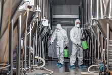 Worker In Hazmat Suit Making D...