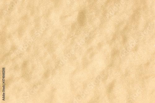 Obraz na plátně Closeup shot of pure golden sand - perfect for background