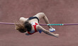 Athlete jumping over the bar in the pole vault sport