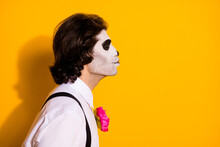 Closeup Profile Photo Of Creepy Zombie Dreamy Guy Empty Space Send Air Kiss Bride Corpse Wear White Shirt Rose Sugar Skull Death Costume Suspenders Isolated Yellow Color Background
