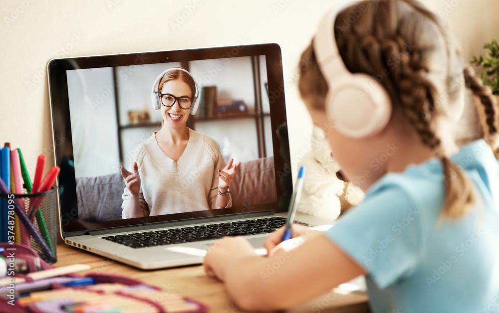Fototapeta Girl listening to friendly teacher during online lesson.
