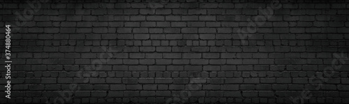 Photo Black brick wall wide texture