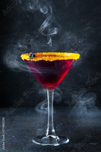 Fotografie, Obraz Halloween coctail black widow with red drinks in glass on dark background