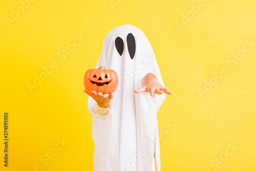 Obraz na plátne Funny Halloween Kid Concept, little cute child with white dressed costume hallow