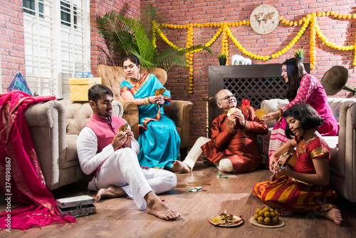 Indian family playing Three Cards or Teen Patti in Diwali or Deepavali festival Wallpaper Mural