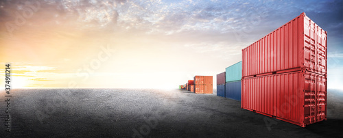 Containers box from cargo freight ship in dockyard with copy space and empty gro Fototapeta