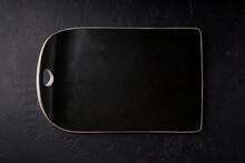 Black Stone Tray On A Black Ba...