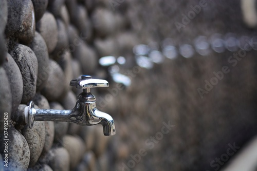 Stainless steel water taps for ablution in the mosque Wallpaper Mural