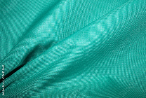 Soft drapery of turquoise fabric. Canvas Print
