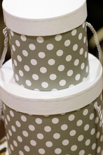 Gray Round Gift Boxes With Whi...
