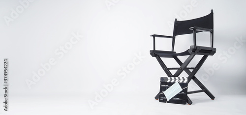 Fototapeta Director chair and black Clapper board or movie slate with face mask