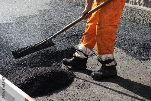 Fotografie, Obraz Paving the road with porous asphalt for traffic noise