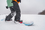 man snowboarding down by hill