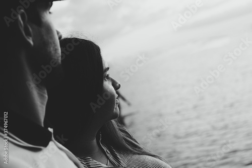 Black and white photo of a young couple in love hugging and looking romantically into the distance Canvas Print