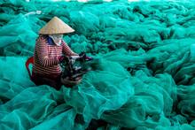 Woman Repairing Fishing Nets, Vietnam