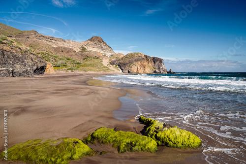 Moss covered rocks on Barronal Beach, Cabo de Gata, Almeria, Andalusia, Spain - 374970011