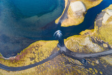 Abstract Aerial View Of A Car Fording A Stream Of Water At A 4WD Road, Veidivotn, Iceland