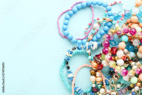 Colorful bracelets on blue background Canvas Print