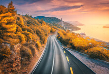 Aerial View Of Mountain Road And Beautiful Orange Forest At Colorful Sunset In Autumn. Dubrovnik, Croatia. Top View Of Road, Trees, Sea, Mountain, Red Sky In Fall. Landscape With Highway And Sea Coast
