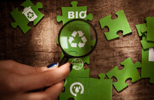 Pieces Of A Green Jigsaw Puzzle With Eco Symbols.