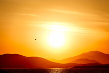 Sunset Over The Sea And Mounta...