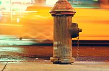 Hydrant On The Sidewalk