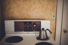 Vintage Stove And Kettle In Old Apartment