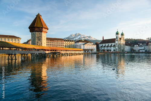 Chapel Bridge in Luzern with Pilatus - 374995603