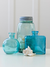 Glass Bottles And Shell